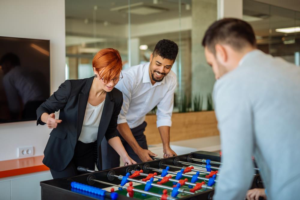 employees playing foosball