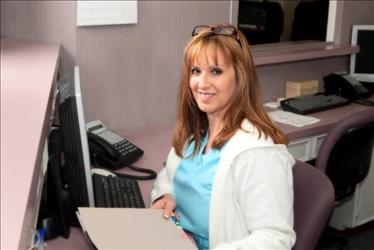 Dental office manager sitting at her desk