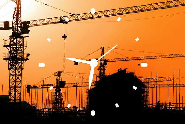 Construction site at sunset with clock image in foreground