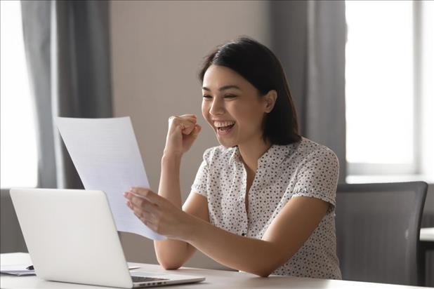 Woman excited about job salary offer
