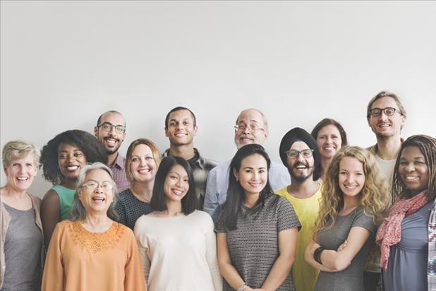 A group of diverse employees smiling for the camera