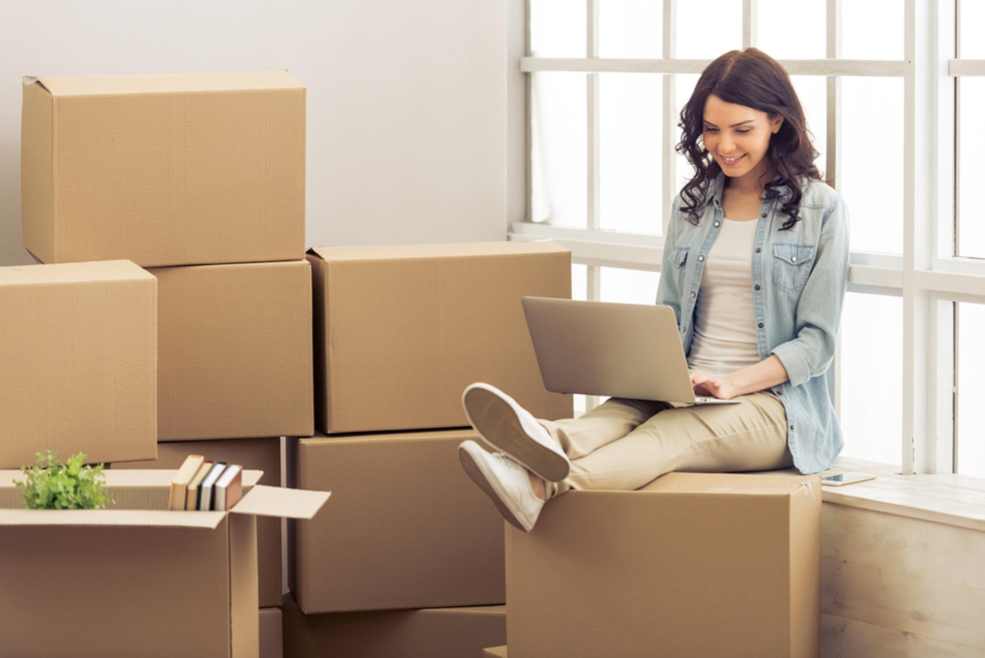woman moving sitting on boxes