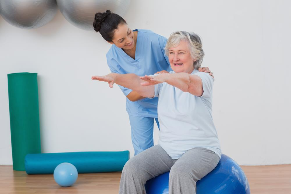 occupational therapist helping a client exercise