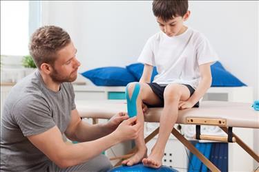 physical therapist with a pediatric patient