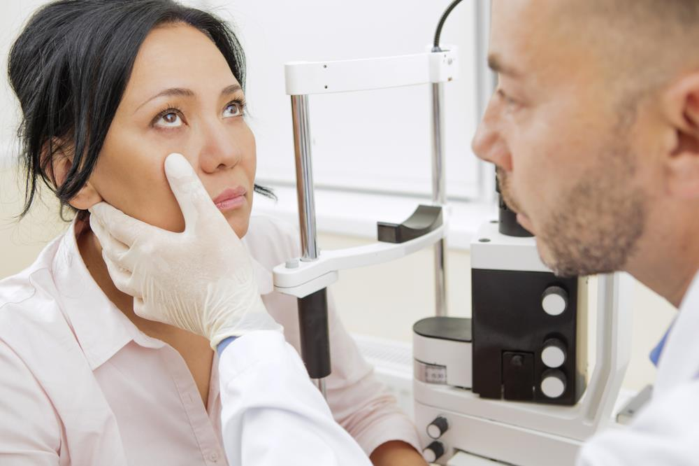 Optometrist examining patient in a modern office
