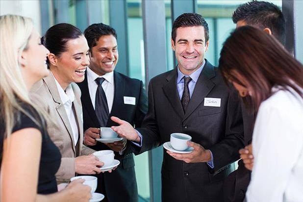 Group of professionals networking in person