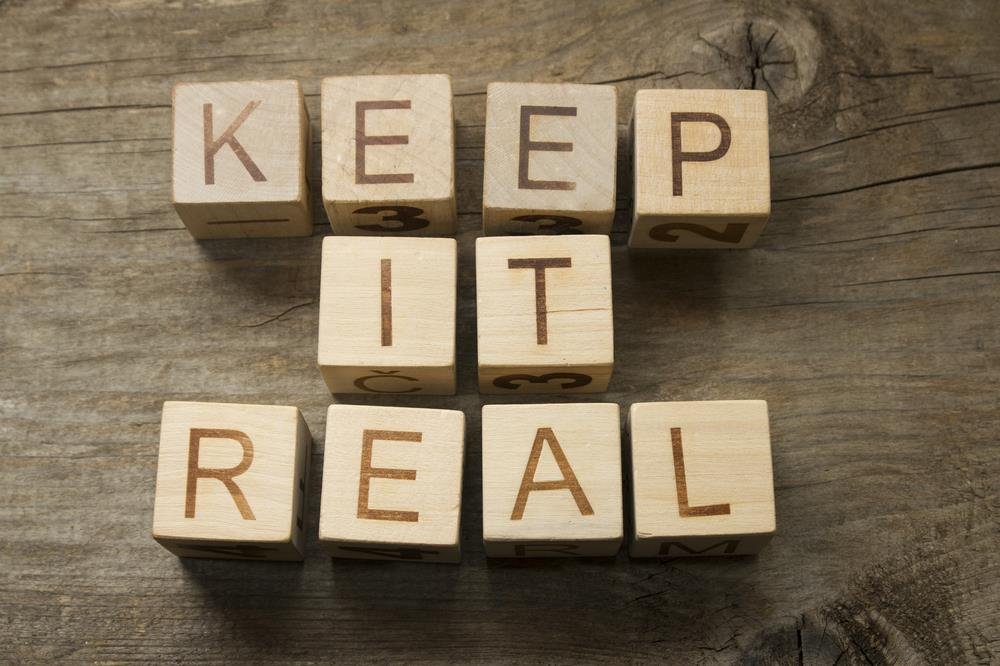 "Wooden blocks that say ""keep it real"""