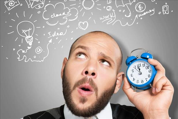 man holding a clock and brainstorming ways to spend his time