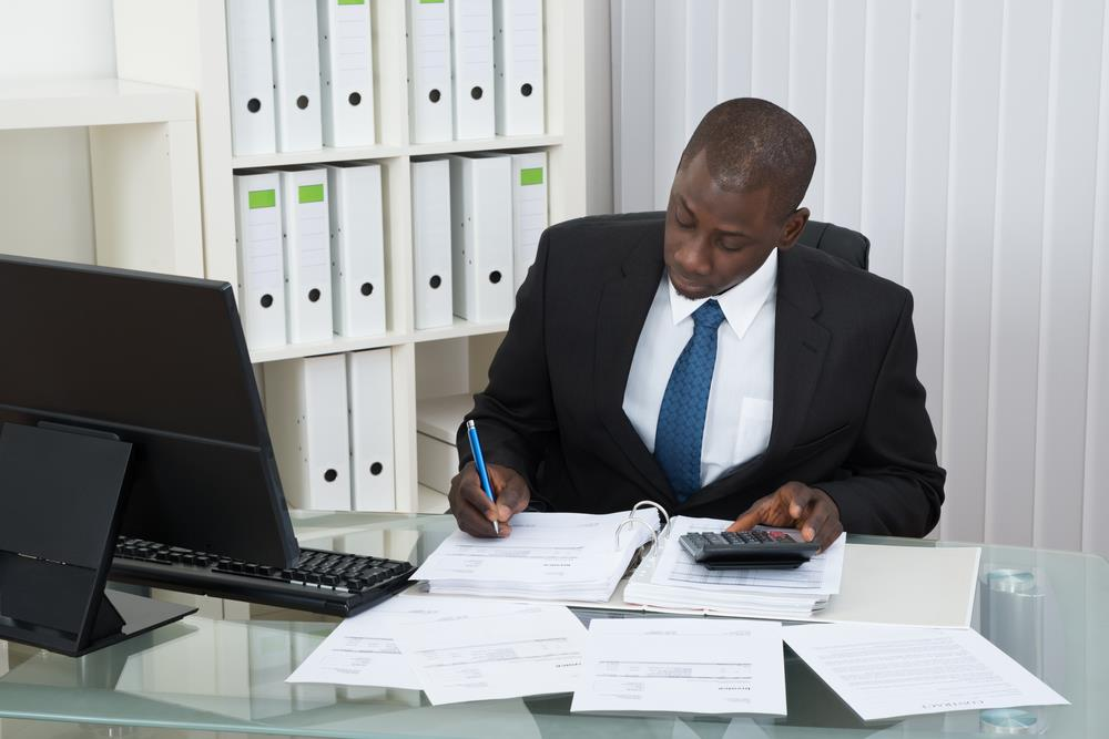 tax accountant reviewing financial information