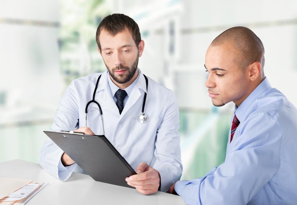 healthcare administrator looking at data with a physician