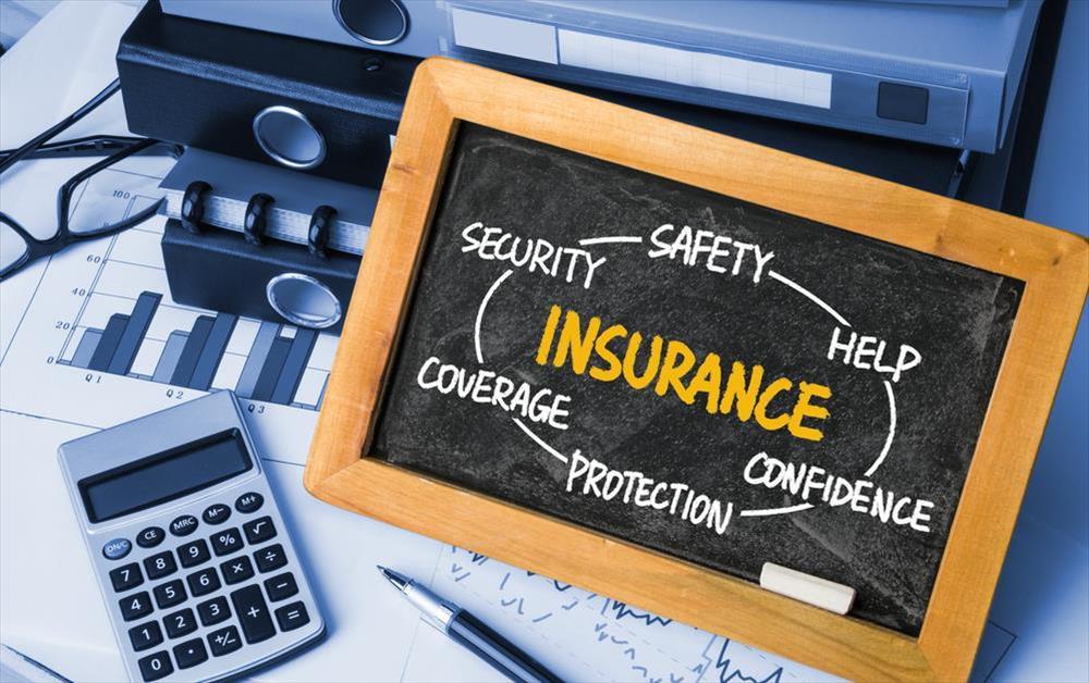 Insurance written on chalkboard