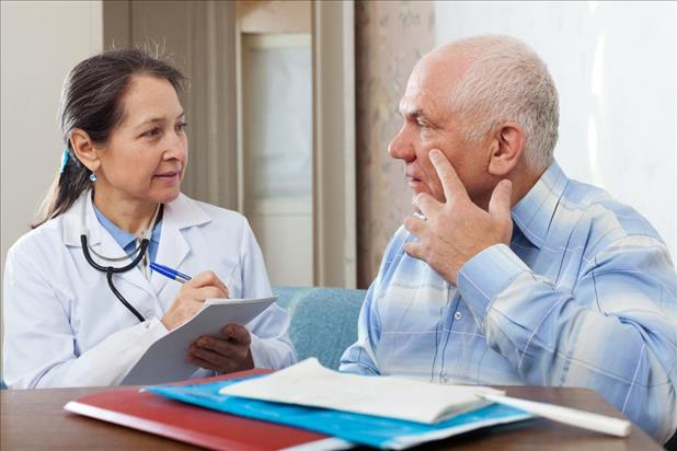 patient in a community health clinic explaining his eye symptoms to a medical provider