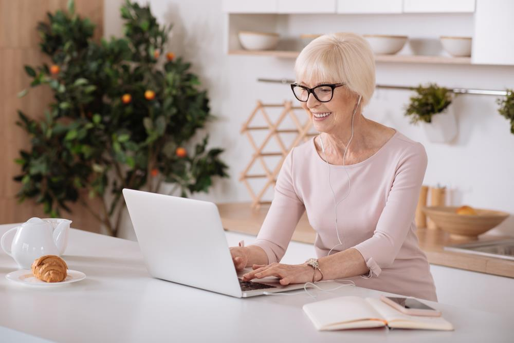 job seeker searching for part-time jobs you can do from home on her laptop