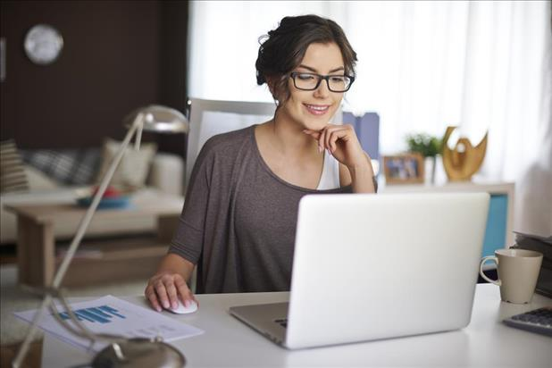 professional enjoying her remote part-time job while working on a laptop