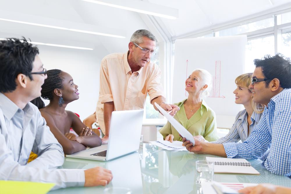 Man giving career coaching to a group of professionals