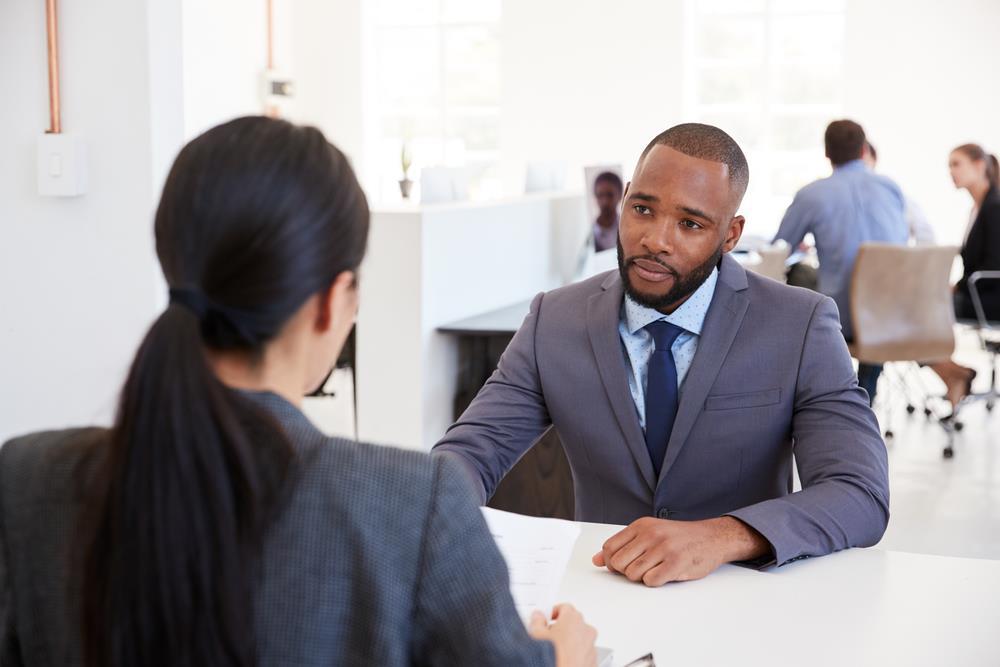 job seeker listening to their interviewer answer a question