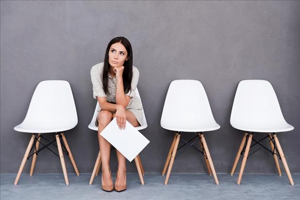 job seeker waiting for an interview and thinking about what questions to ask