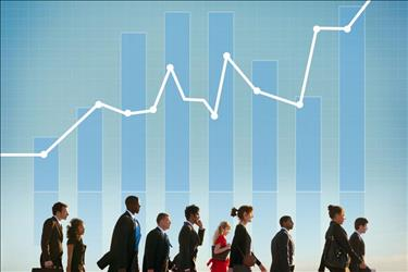 Group of professionals walking with line graph showing positive growth