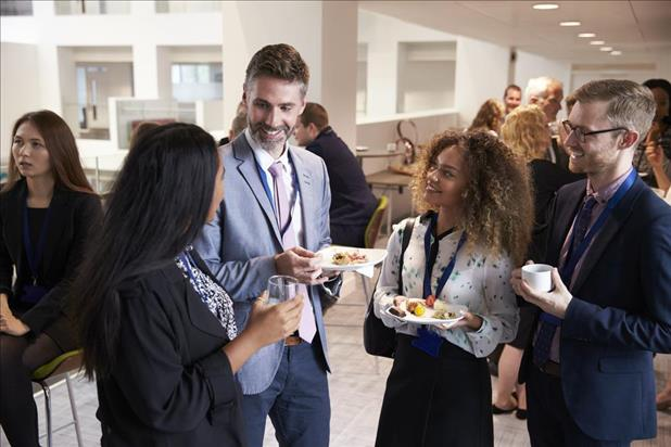 Salespeople network while eating food