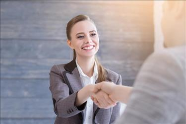 job seeker shaking hands with her interviewer