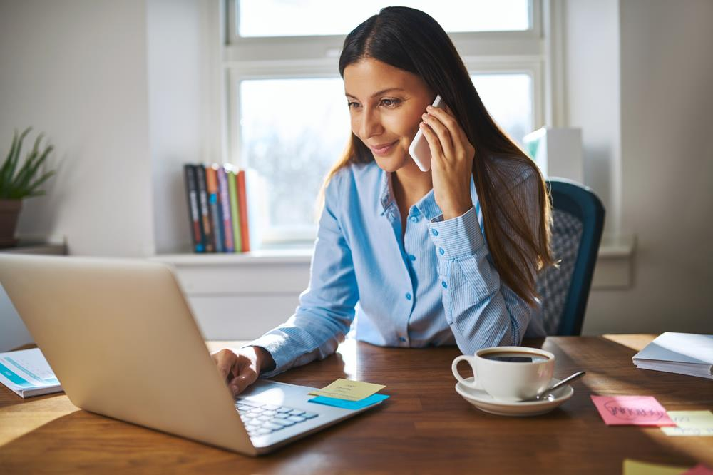 Woman on the phone while working part-time job from home