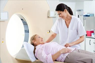 Radiologist putting patient at ease before performing MRI