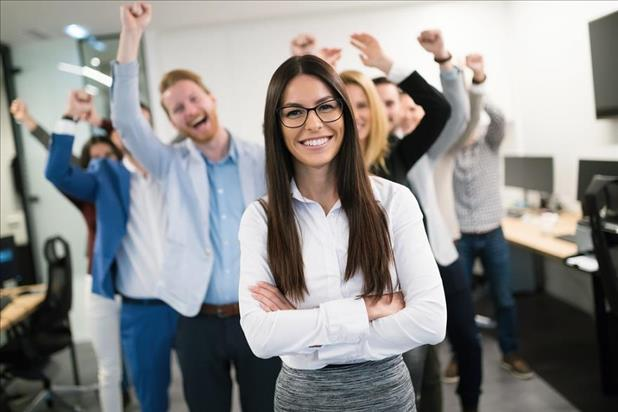 happy female employee being recognized by her team