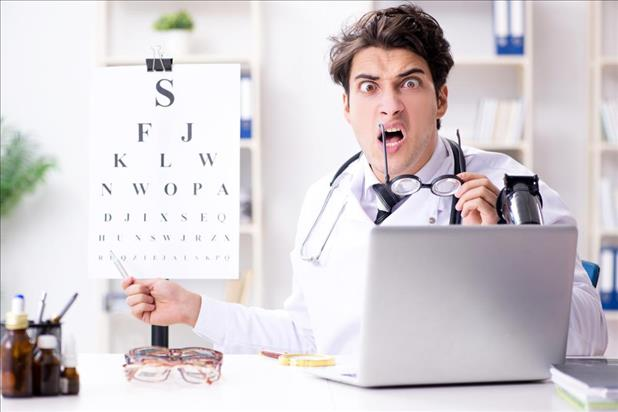 optometrist making a funny face