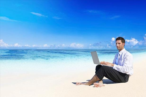 Job seeker on the beach looking for opportunities during vacation