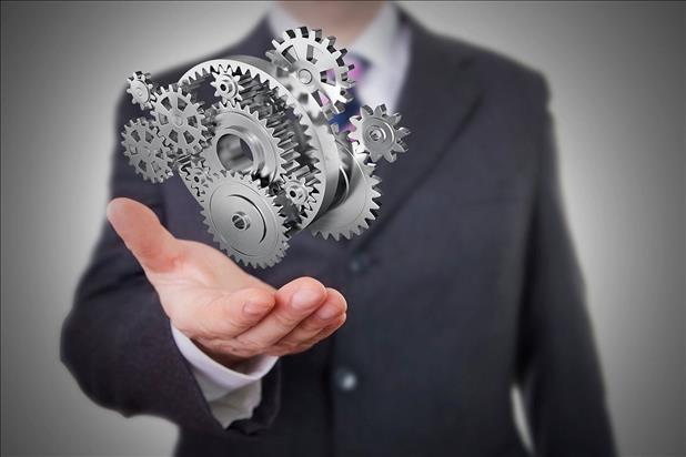 Abstract image of HR professional holding gears