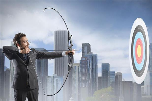 Job seeker with bow and arrow aiming at a target