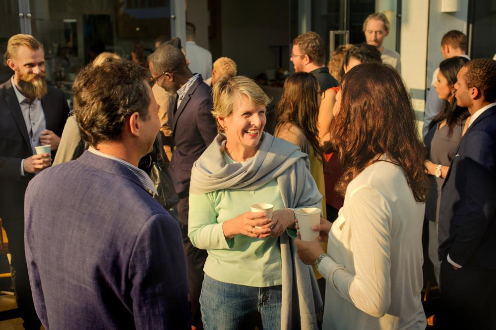 Professionals chatting at a networking event