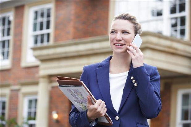 property manager making a phone call outside of a building