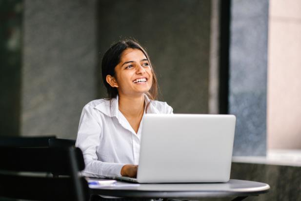 woman looking up from computer