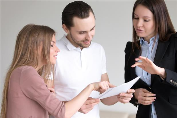 personal banker going over paperwork with her clients