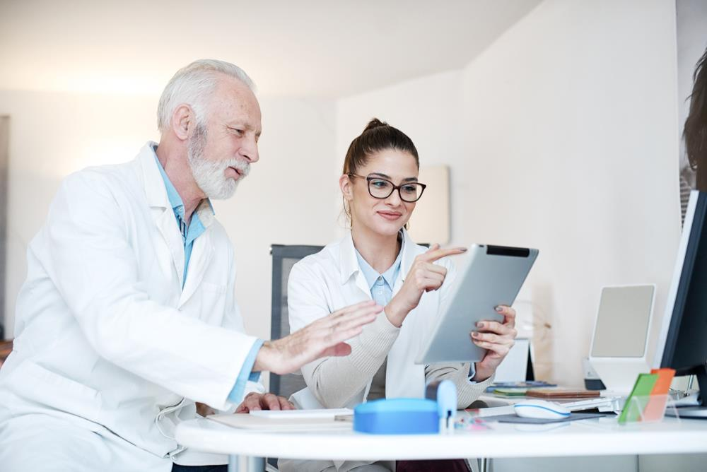 two optometry team members reviewing a resume