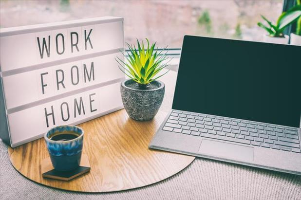 laptop on desk with work from home sign