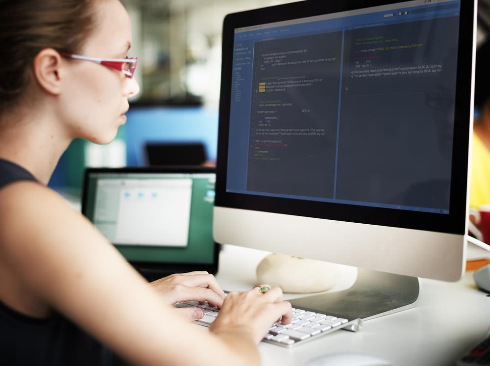 programmer at her desk