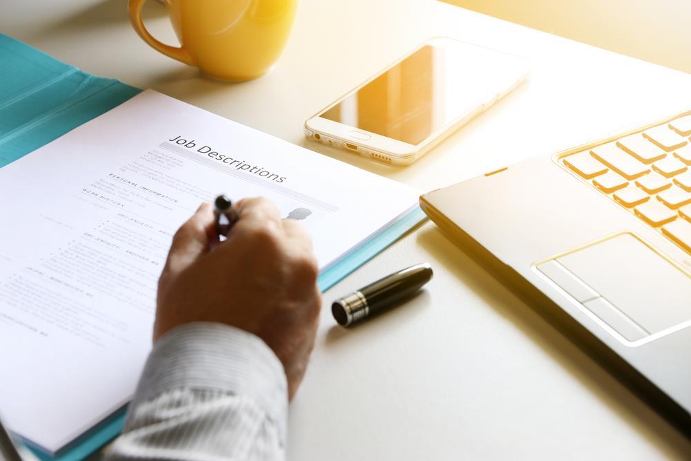 hr professional at his desk reviewing a job description