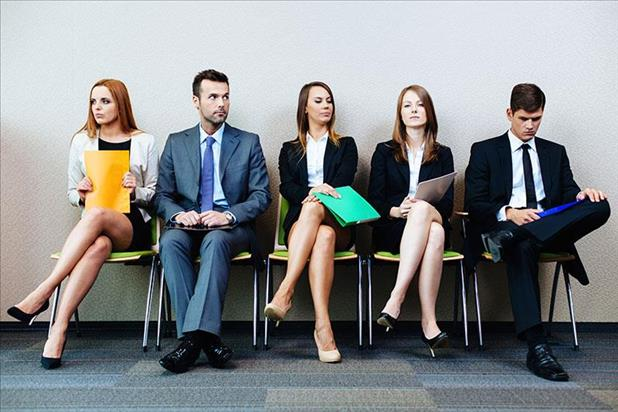Group of job seekers wearing appropriate interview attire