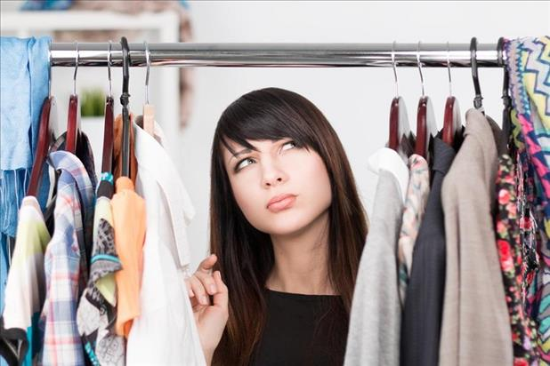 woman deciding what to wear for an interview