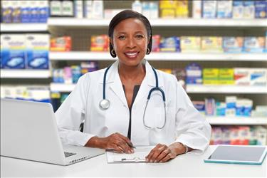 pharmacist at her desk