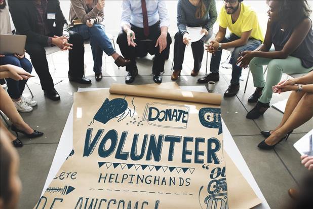 employees meeting to plan volunteerism