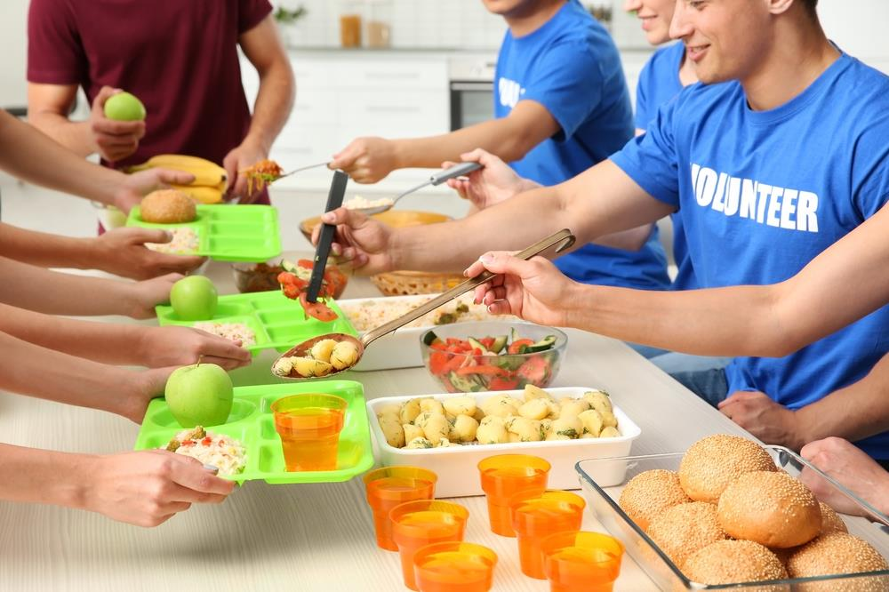 group of employees volunteering together serving lunch