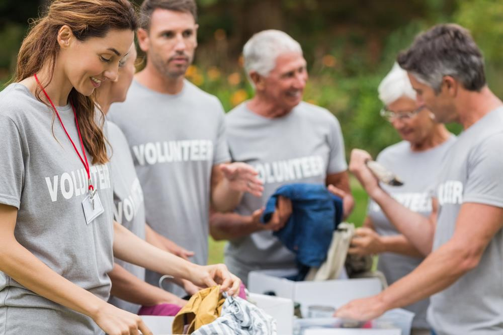 employees volunteering together to sort donations