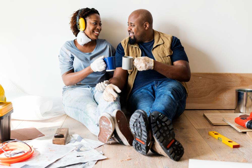 couple taking time off work to complete home improvement projects during their staycation