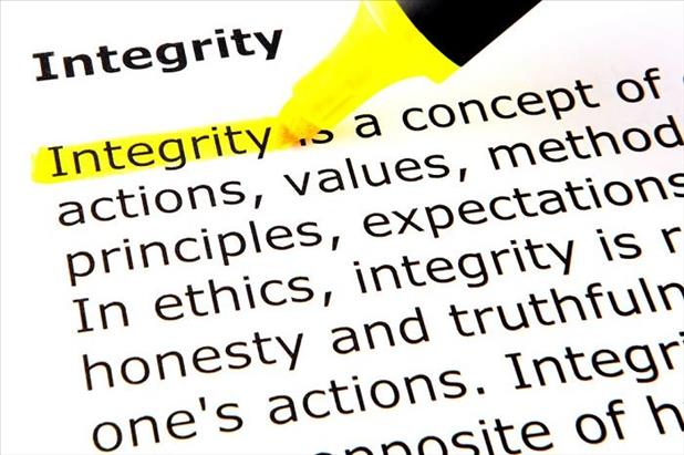 Closeup of someone highlighting the definition of integrity
