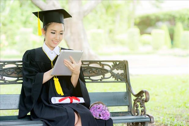 new graduate searching for jobs on her tablet