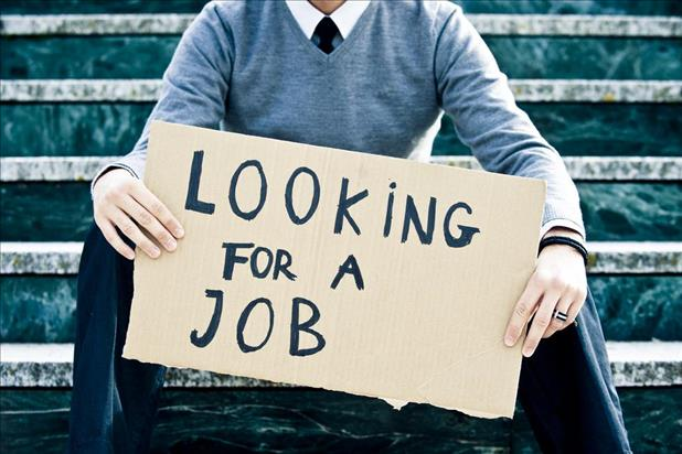 "Businessman holding sign that says ""Looking for Job"""