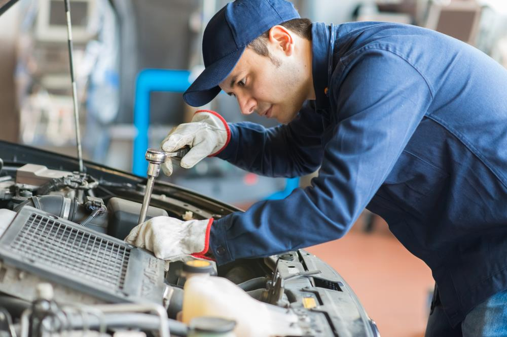 automotive technician working on a car